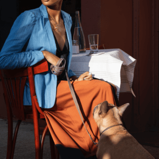 woman with dog at restaurant near two blue slip greenpoint landing apartments